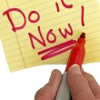 Hand Writing Do It Now - Stock Photo