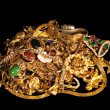 Stock Photo: Pile Of Gold Jewelry On Black