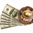 Stock Photo: Golden Nest Egg With Lots Of Money Isolated On White