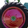 Stock Photo: Large Vintage Red Tractor Tire
