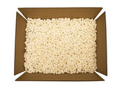 Packing Peanuts In  Cardboard Box — Stock Photo
