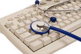 Close Up Shot Of Stethoscope On Computer Keyboard — Stock Photo