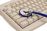 Stethoscope And Keyboard Isolated — Stock Photo
