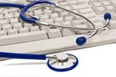 Computer Keyboard and Stethoscope Isolated Find Medical Information Online — Stock Photo