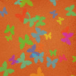 Orange background with butterflies — Stock Photo