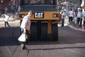 Old man walking on asphalt — Stock Photo