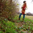 Foto Stock: Girl walking in forest