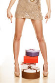 Presents, and beautiful legs — Stock Photo