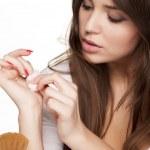 Постер, плакат: Removing a nail polish