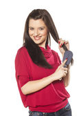 Girl combs her hair — Stock Photo