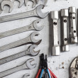 Stock Photo: Wall with wrenches