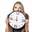 Shocked girl holding a clock — Stock Photo #50444073