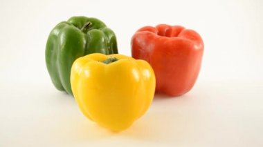 Yellow, Green and Red Peppers Against White - Triangle Arrangement - Dolly Right — Stock Video