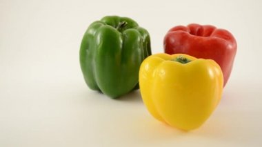 Yellow, Green and Red Peppers Against White - Triangle Arrangement - Dolly Left — Stock Video