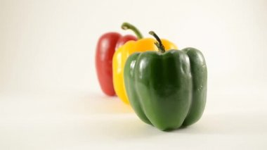 Green, Yellow and Red Peppers Against White - Line Arrangement - Dolly Right — Stock Video