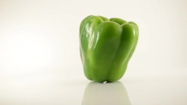 Rotating Green Pepper On Acrylic Against White - Dolly Right — Stock Video