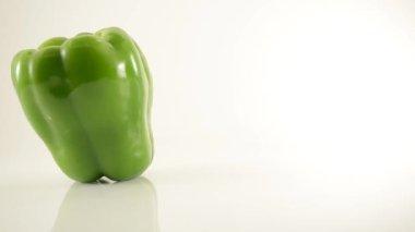 Rotating Green Pepper On Acrylic Against White - Dolly Left — Stock Video