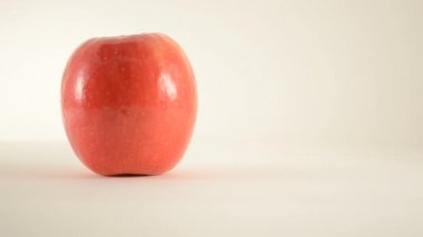 Rotating Pink Lady Apple Against White - Dolly Right — Stock Video