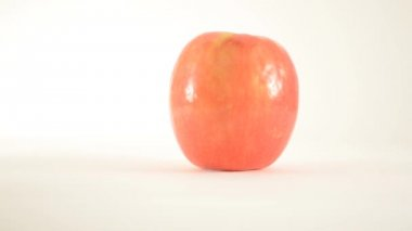 Rotating Pink Lady Apple Against White - Dolly Left — Stock Video