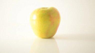 Rotating Honeycrisp Apple On Acrylic Against White - Dolly Left — Stock Video