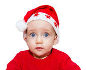 Surprised boy with big eyes in red Christmas cap isolated on whi — Stock Photo