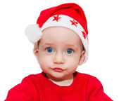 Сharming beautiful child looks forward in red cap claus — Stock fotografie
