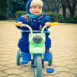 Child playing on bicycle — Stock Photo #25973093