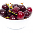White ceramic bowl with ripe cherries — Stock Photo