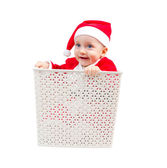 Funny boy in Santa Clause suit hiding in a box — Stock Photo