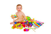 Crying child plays with toys — Stock Photo