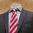 Dark grey jacket with red & white striped tie — Stock Photo #17436899