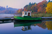 Boat at a Pier on a Misty Autumn Morning — Stock Photo