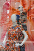 Two Colourful Mannequins in a Shop Window — Stock Photo