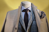 Beige Coat & Checkered Jacket — Stock Photo