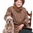 Old woman and dog - Stock Photo