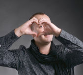Man making heart sign — Stock Photo