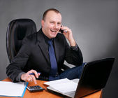Young businessman at his workplace — Stock Photo