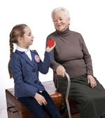 Grandmother and granddaughter with a heart — Stock Photo