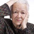 Portrait of old woman suffering from a headache — Stock Photo