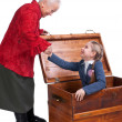 Grandmother finding her granddaughter in the chest — Stock Photo