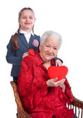 Granddaughter hugging her grandmother — Stock Photo