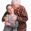 Grandmother kissing her granddaughter - Stock Photo
