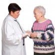 Old woman having discussion with her doctor — Stock Photo