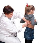 Senior pediatrician examing girl — Stock Photo
