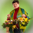 Senior woman with bouquets of flowers — Stock Photo