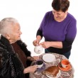 Mother having tea with her daughter — Stock Photo #21579623