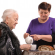 Mother having tea with her daughter — Stock Photo