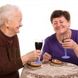 Happy mother with daughter drinking wine — Stock Photo #21581357