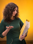 Portrait of business woman with folders — Stock Photo