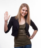 Portrait of young blond pointing up — Stock Photo